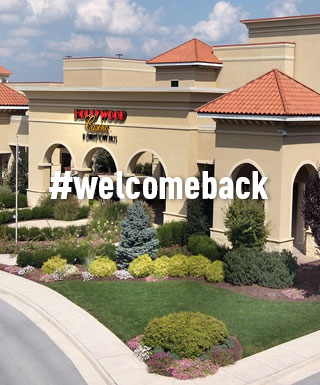 "Hollywood Casino at CHarles Town Races property exterior with text ""#welcomeback"""